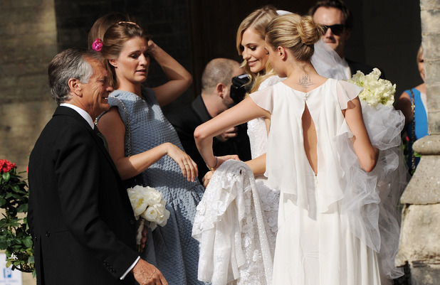 Poppy Delevingne and Cara Delevingne arrive for Poppy's wedding at St. Pauls, Knightsbridge