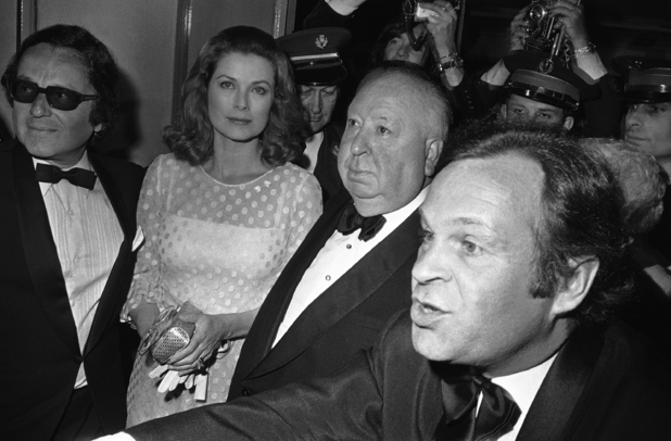 British film director and producer Alfred Hitchcock, second from right, and Princess Grace of Monaco, arrive on May 18, 1972 at the festival theatre in Cannes, France, for the closing ceremony. (AP Photo/AP Photo/Jean Jacques Levy)