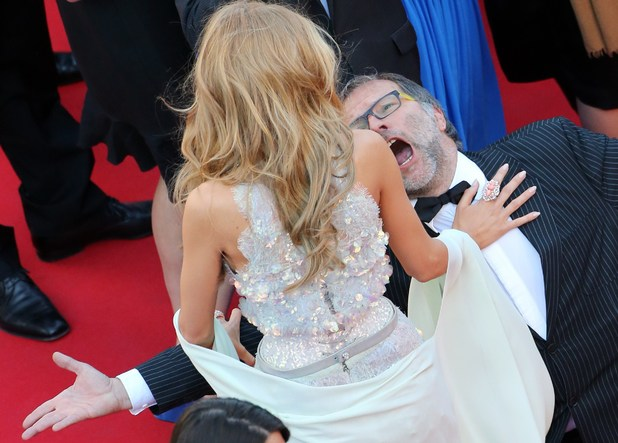 A guest kneels down in front of US actress Blake Lively as she arrives for the screening of the film 'Mr. Turner' at the 67th edition of the Cannes Film Festival in Cannes, southern France, on May 15, 2014. AFP PHOTO / LOIC VENANCE (Photo credit should read LOIC VENANCE/AFP/Getty Images)