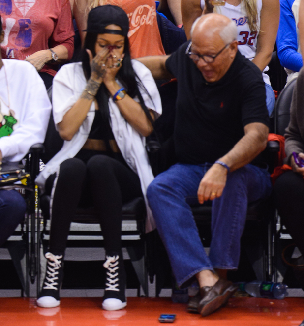 Rihanna smashes her phone at the NBA playoff game between the Oklahoma City Thunder and the Los Angeles Clippers