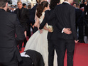 Prankster tried to hide under actress's dress on the red carpet.