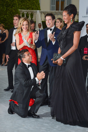 CAP D'ANTIBES, FRANCE - MAY 22: John Travolta and Kelly Preston witness a marriage proposal at amfAR's 21st Cinema Against AIDS Gala, Presented By WORLDVIEW, BOLD FILMS, And BVLGARI at the 67th Annual Cannes Film Festival on May 22, 2014 in Cap d'Antibes, France. (Photo by George Pimentel/WireImage)