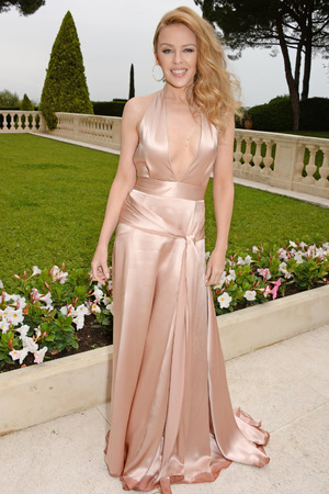 CAP D'ANTIBES, FRANCE - MAY 22: Kylie Minogue attends amfAR's 21st Cinema Against AIDS Gala presented by WORLDVIEW, BOLD FILMS, and BVLGARI at Hotel du Cap-Eden-Roc on May 22, 2014 in Cap d'Antibes, France. (Photo by Dave M. Benett/amfAR14/WireImage)
