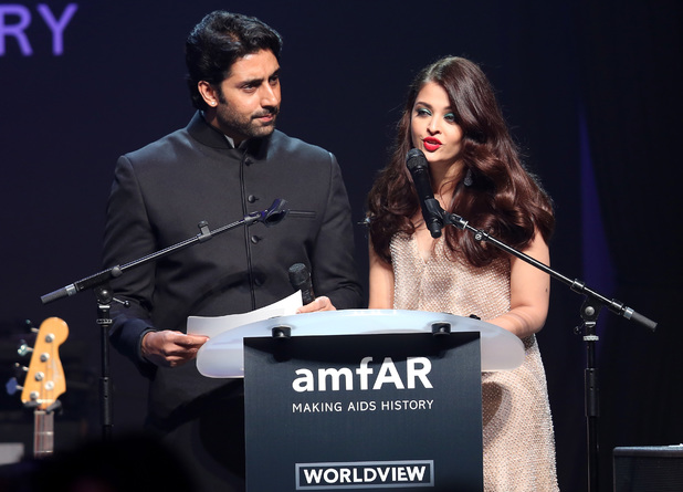 Abhishek Bachchan and Aishwarya Rai onstage during amfAR's 21st Cinema Against AIDS Gala
