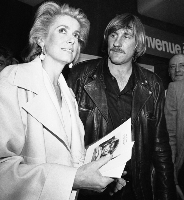 French movie star Catherine Deneuve and actor Gerard Depardieu leave the Festival Palace after a press conference where they presented the French movie Fort Saganne in Cannes on May 11, 1984. (AP Photo/ Michel Lipchitz)