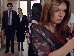 The police arrive to take Carla for further questioning