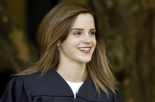Emma Watson is escorted by an armed guard at Brown University