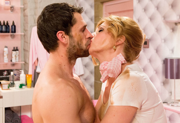 Andy and Bernice kiss in the beauty salon
