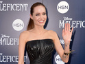 The actress is considering action over an old video of Jolie allegedly taking drugs.