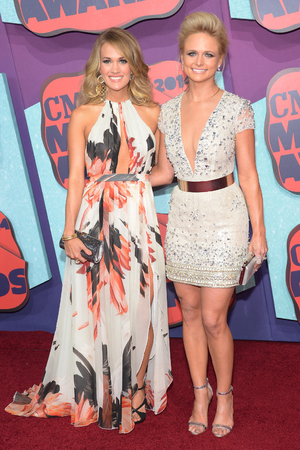 NASHVILLE, TN - JUNE 04: Carrie Underwood and Miranda Lambert attend the 2014 CMT Music awards at the Bridgestone Arena on June 4, 2014 in Nashville, Tennessee. (Photo by Michael Loccisano/Getty Images)