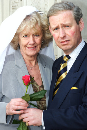 PRINCE CHARLES AND CAMILLA PARKER BOWLES LOOKALIKES PROMOTING LBC RADIO STATION'S DEBATE OVER THE ROYAL WEDDING, LONDON, BRITAIN - 13 FEB 2005 Camilla Parker Bowles and Prince Charles lookalikes 13 Feb 2005