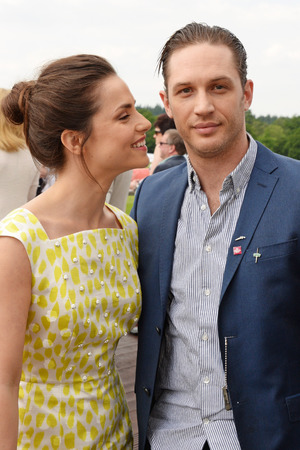 ASCOT, ENGLAND - JUNE 01: Tom Hardy (L) and Charlotte Riley attend day two of the Audi Polo Challenge at Coworth Park Polo Club on June 1, 2014 in Ascot, England. (Photo by David M. Benett/Getty Images for Audi)