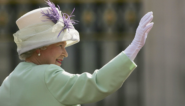 LONDON, UNITED KINGDOM - JULY 10: HM Queen Elizabeth II, The Queen, waves before watching the flypast over the Mall of British and US World War II aircraft from the Buckingham Palace balcony on National Commemoration Day July 10, 2005 in London. Poppies were dropped from the Lancaster Bomber of the Battle Of Britain Memorial Flight as part of the flypast. (Photo by Daniel Berehulak/Getty Images)