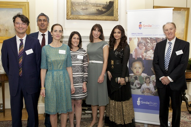 Aishwarya Rai Bachchan at the Smile Train reception at Downing Street alongside Edoardo Monopoli, Amerjit Chohan, Vera Pellegrin, Susannah Schaefer, Samantha Cameron & John Dunningham