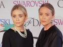 Olsen sisters appear in their first Vine, but believe they are posing for a photo.