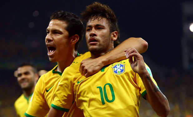Neymar of Brazil celebrates scoring his second goal on a penalty kick in the second half during the 2014 FIFA World Cup Brazil Group A match between Brazil and Croatia