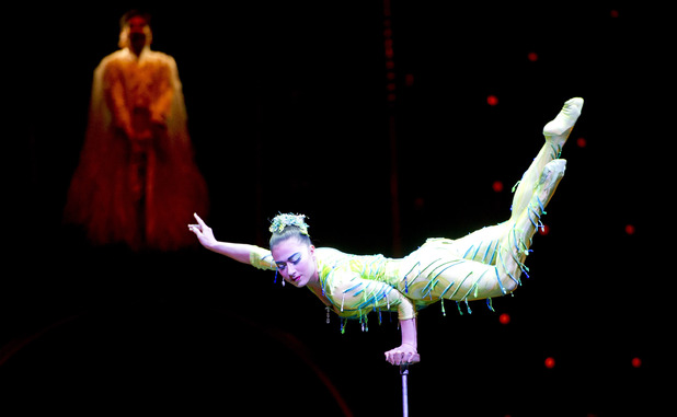 Dilinuer Kadier from Cirque du Soleil on stage in Dralion at London O2 Arena