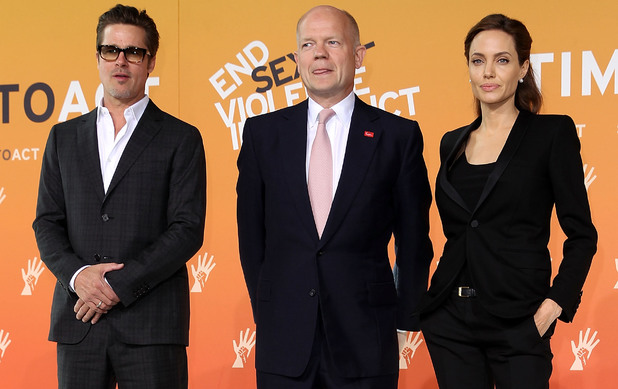 Brad Pitt and Angelina Jolie pose with William Hague at the Global Summit to end Sexual Violence in Conflict at ExCel, London