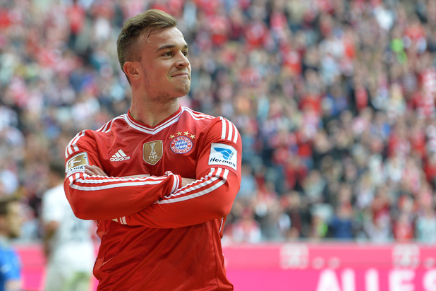 Bayern's Xherdan Shaqiri of Switzerland smiles after scoring during the German first division Bundesliga soccer match between FC Bayern Munich and SC Freiburg in Munich, Germany, on Saturday, Feb. 15, 2014. (AP Photo/Kerstin Joensson)