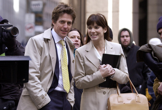 Caption:Hugh Grant and Sandra Bullock during Sandra Bullock and Hugh Grant Filming 'Two Weeks Notice' in New York City on March 11, 2002 at Downtown Manhattan in New York City, New York, United States. (Photo by Tom Kingston/WireImage)