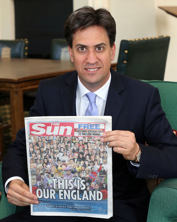 Ed Miliband poses with a copy of The Sun newspaper
