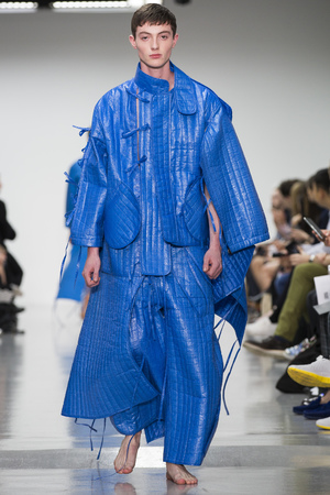 LONDON, ENGLAND - JUNE 17: A model walks the runway at the Craig Green show during the London Collections: Men SS15 on June 17, 2014 in London, England. (Photo by Tristan Fewings/Getty Images)