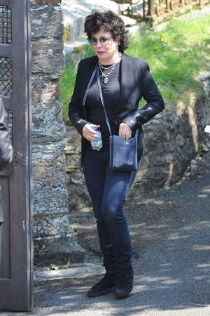 Ruby Wax arrives for the funeral of Rik Mayall at St George's church in Dittisham