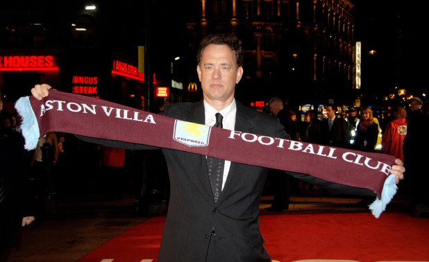 LONDON - JANUARY 09: (EMBARGOED FOR PUBLICATION IN UK TABLOID NEWSPAPERS UNTIL 48 HOURS AFTER CREATE DATE AND TIME) Actor Tom Hanks poses on the red carpet with an Aston Villa FC football scarf on arriving at the European premiere of 'Charlie Wilson's War', at the Empire Cinema on January 9, 2007 in London, England. (Photo by Dave M. Benett/Getty Images)
