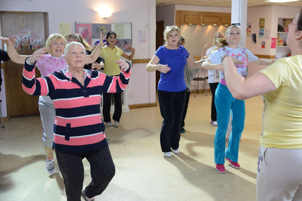 Pam, Mo, Cora and Linda follow Sonia's lead at the Fat Busters class
