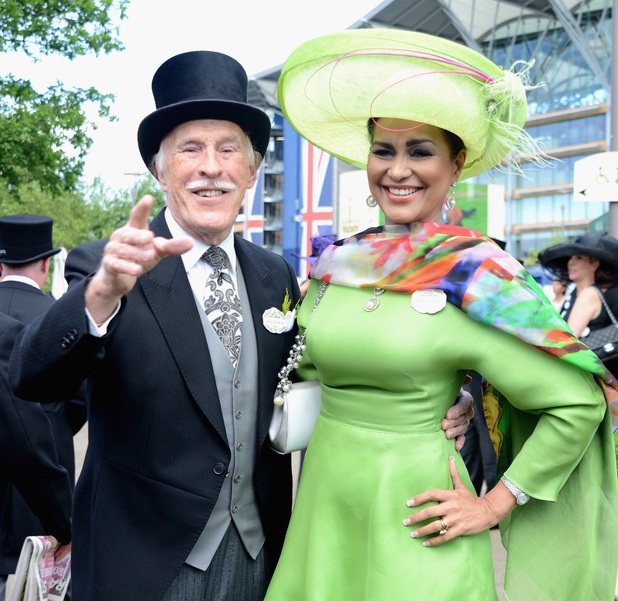 ASCOT, ENGLAND - JUNE 17: Presenter Bruce Forsyth and his wife Merced Wilnelia attend day one of Royal Ascot at Ascot Racecourse on June 17, 2014 in Ascot, England. (Photo by Kirstin Sinclair/Getty Images for Ascot Racecourse)