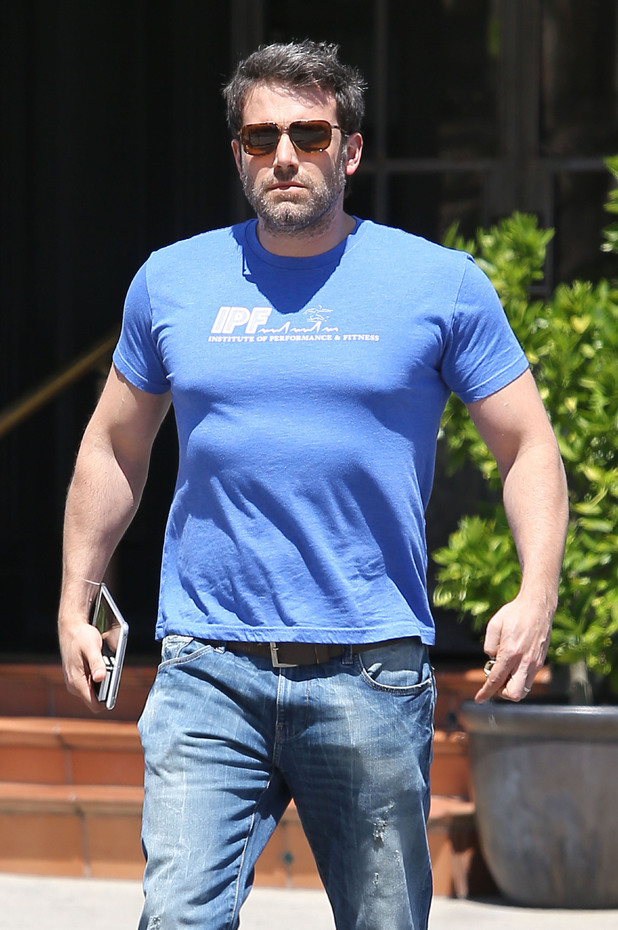 Headline: Ben Affleck shows his inner Batman after lunch Date of Picture: 05/13/2014 See the set: SPL757612 Usage: NO ARGENTINA, BRAZIL, CROATIA, CZECH REPUBLIC, DEN Caption: UK CLIENTS MUST CREDIT: AKM-GSI ONLY Ben Affleck sucks it in his gut and puffs up his chest as he walks to his car after having lunch at The Tavern in Brentwood. The 'Batman' star looked like he was still in character as he exited the eatery in a tight blue t-shirt and jeans. Ben puffed up his chest and arms as he looked into the camera showing off his new physic while getting into his own Batmobile, rather a vintage red car.