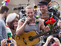 Fans film the Coldplay frontman during the making of their latest video.