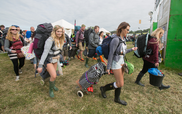 First festival-goers walk through the gates at Glastonbury 2014.