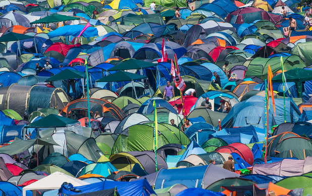 A field of tents is bathed in sunshine during the Glastonbury Festival at Worthy Farm on June