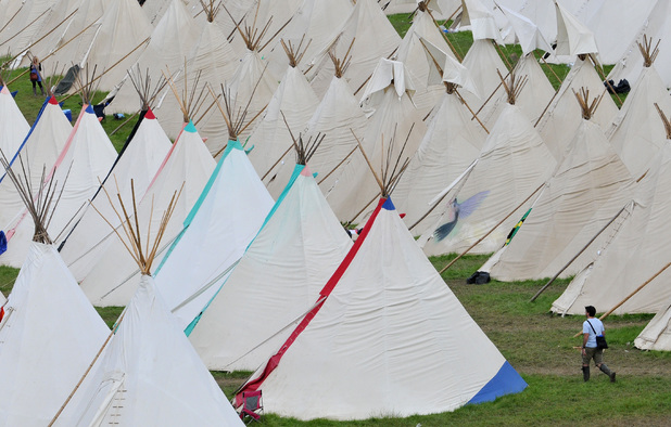 A man walks through the teepee field during day three of the Glastonbury Festival at Worthy Farm