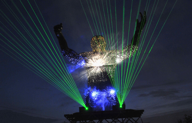 An impressive laser light show in the dance village at Glasonbury 2014