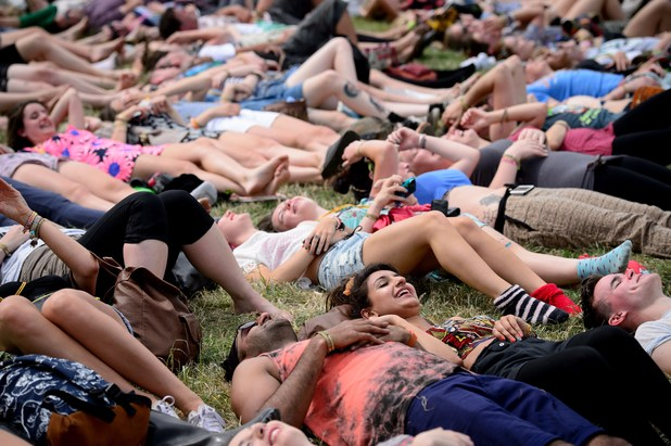 Festival goers take part in a 'Yoga Laughter' session