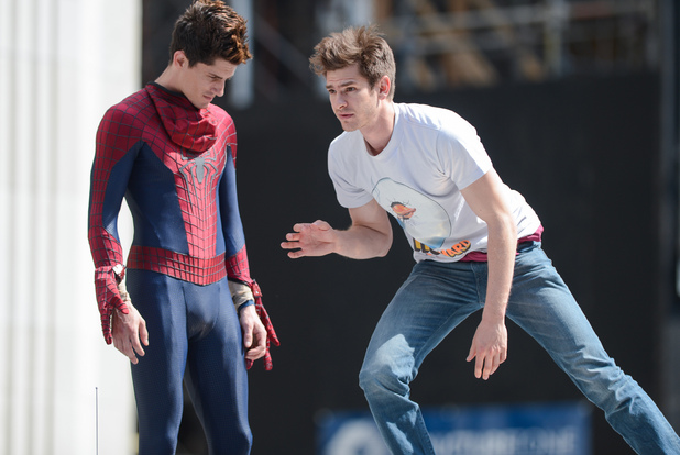 Caption:NEW YORK, NY - JUNE 22: Actor Andrew Garfield (R) rehearses a scene with his stunt double William Spencer at the 'The Amazing Spiderman 2' movie set in Madison Square Park on June 22, 2013 in New York City. (Photo by Ray Tamarra/Getty Images)