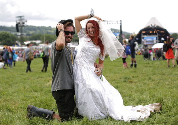 Newly weds Craig Reilly and Hannah Lomas from Liverpool celebrate together at Glastonbury Festival 2014