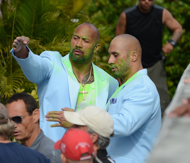 "Set of Pain and Gain 2012 Date of Picture: 04/14/2012 See the set: SPL772537 Usage: World Rights Caption: Dwayne Johnson and his stuntman on the set of the new movie Pain and Gain which is directed by Michael Bay . Dwayne Douglas Johnson (born May 2, 1972), also known by his ring name The Rock, is an American actor and professional wrestler who is signed to WWE, appearing on the Raw brand He is often credited as Dwayne ""The Rock"" Johnson. on April 14, 2012 in Miami Beach, Florida.Pictured: Dwayne Johnson_Stunt Man Ref: SPL772537 140412Picture by: Brock Miller"