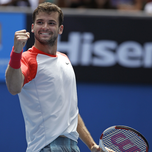 Grigor Dimitrov of Bulgaria celebrates after defeating Roberto Bautista Agut of Spain during their fourth round match at the Australian Open tennis championship in Melbourne, Australia, Monday, Jan. 20, 2014.(AP Photo/Aijaz Rahi)