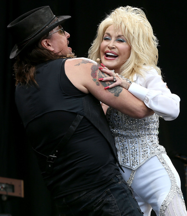 Richie Sambora of US rock group Bon Jovi joins US singer Dolly Parton on the Pyramid Stage