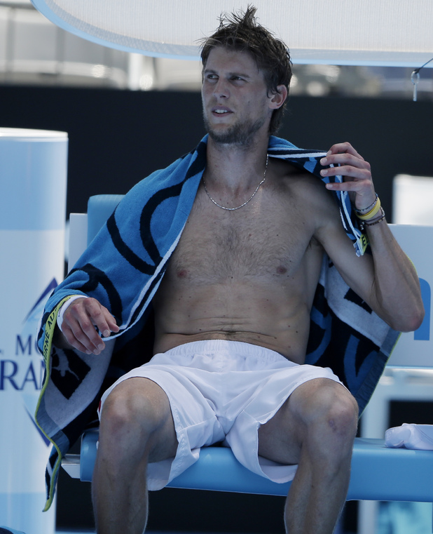 Italy's Andreas Seppi rests in his chair during his fourth round match against France's Jeremy Chardy at the Australian Open tennis championship in Melbourne, Australia, Monday, Jan. 21, 2013. (AP Photo/Rob Griffith)