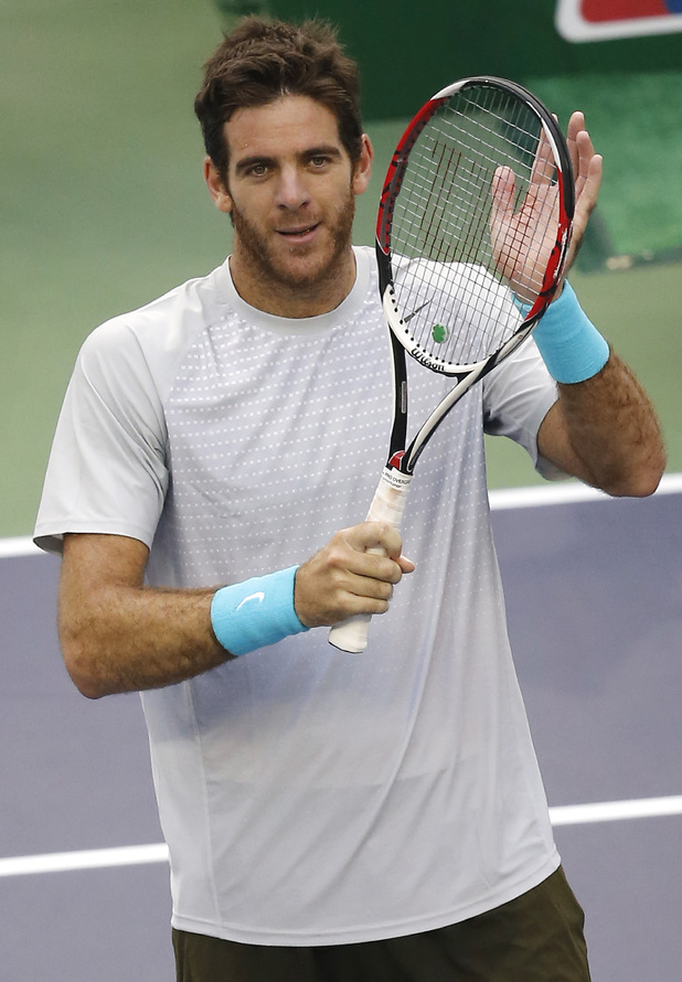 Juan Martin del Potro of Argentina greets the spectators after defeating Nicolas Almagro of Spain during the singles quarterfinal match of the Shanghai Masters tennis tournament at Qizhong Forest Sports City Tennis Center, in Shanghai, China, Friday, Oct. 11, 2013. Del Potro won 6-3, 6-3. (AP Photo/Eugene Hoshiko)