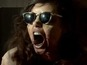 Watch Aubrey Plaza as a zombie man-eater