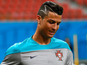Cristiano Ronaldo works out during training at Arena Amazonia