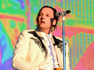 Win Butler of Arcade Fire performs on stage at the British Summer Time Festival at Hyde Park on July 3, 2014 in London, United Kingdom.