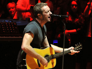 Chris Martin of Coldplay performs live on stage at the Royal Albert Hall