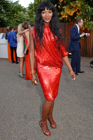 LONDON, ENGLAND - JULY 01: Naomi Campbell attends The Serpentine Gallery Summer Party co-hosted by Brioni at The Serpentine Gallery on July 1, 2014 in London, England. (Photo by David M. Benett/Getty Images for The Serpentine)
