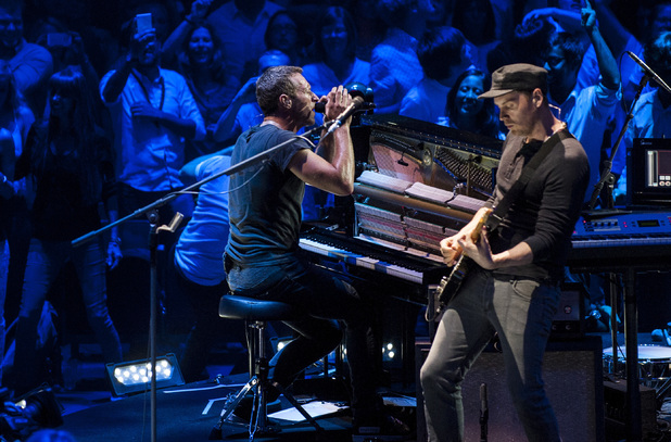 Coldplay performing live on stage at the Royal Albert Hall